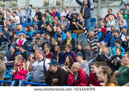 Odessa, Ukraine - sentyabryamaya 15, 2016: Spectators and fans in stands of the stadium during European Cup rugby. Moldova - Ukraine. Viewers react emotionally to umehi and losing teams in the game.
