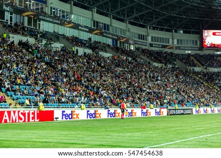 ODESSA, UKRAINE - September 15, 2016: Active fans FENERBAHCE Istanbul and Zarya Lugansk in stands with attributes during match Championship European Football League. Emotions in stands sports audience