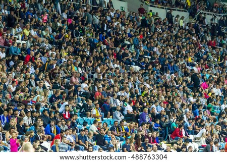 ODESSA, UKRAINE - September 15, 2016: Active fans FENERBAHCE Istanbul and Zarya Luhansk. stands with attributes during match of Championship European Football League Emotions stands of sports audience