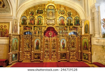 ODESSA, UKRAINE- September 12, 2012: Interior of Orthodox Christian church, altar, iconostasis, and beautiful historic architecture arches, painted icons, frescoes, bas-reliefs in natural lighting.  - stock photo