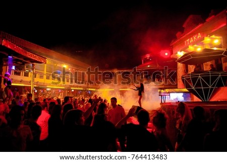 Odessa, Ukraine September 3, 2016: Itaka Night club dj party people enjoy of music dancing sound with colorful light, smoke machine, lights show and dance show. Hands up in the earth.