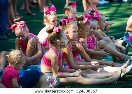 "Odessa, Ukraine - September 2, 2015: Open cheerleading flash mob ""Cher Fest 2015 Odessa"" speech commands cheerleader and single dancers. Cheerleading dance groups are growing in popularity in Ukraine"