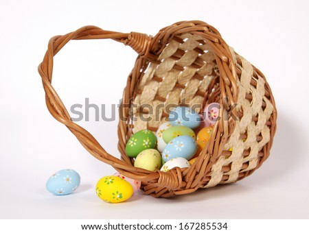 Of a fallen Easter basket spilled painted eggs  - stock photo