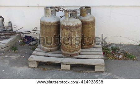 of gas cylinders unattended in the street - stock photo