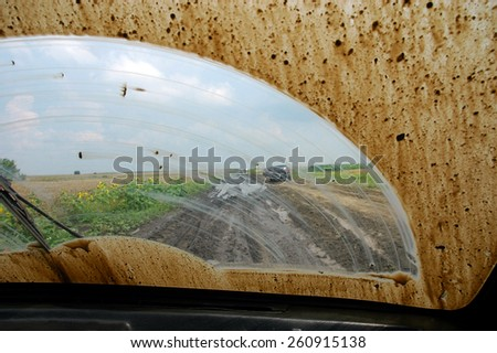 Of road driving through the mud with a dirty windshield - stock photo