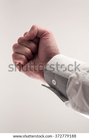 of the hands in a fist on a white background - stock photo