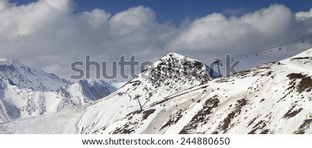 Off-piste slope and chair-lift in little snow year. Caucasus Mountains, Georgia. Ski resort Gudauri. Panoramic view. - stock photo