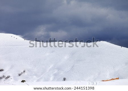 Off-piste slope and gray sky in bad weather day. Caucasus Mountains, Georgia. Ski resort Gudauri. - stock photo