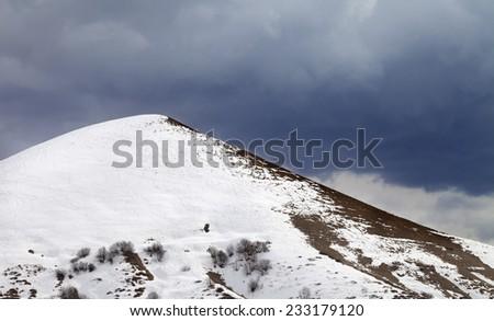 Off-piste slope and overcast gray sky. Caucasus Mountains, Georgia, ski resort Gudauri. - stock photo