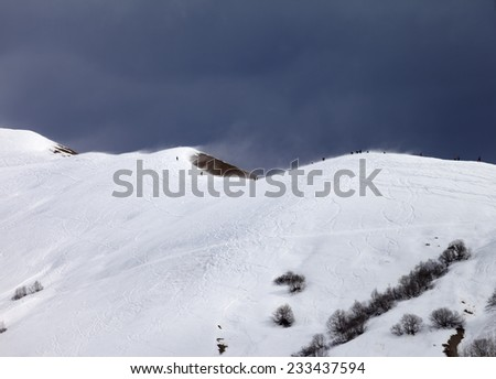 Off piste slope and overcast gray sky in windy day. Caucasus Mountains, Georgia. Ski resort  - stock photo