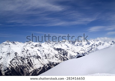 Off-piste slope and snowy mountains. Caucasus Mountains. View from ski resort Dombay on Elbrus region. - stock photo