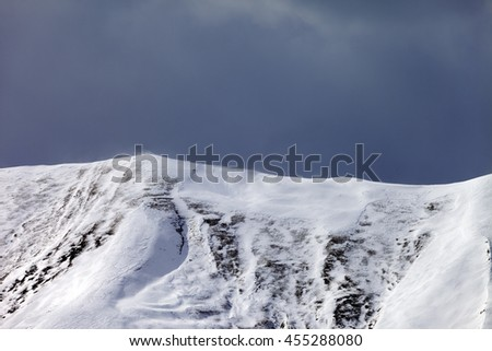 Off-piste slope and storm gray clouds. Caucasus Mountains, Georgia, ski resort Gudauri. - stock photo