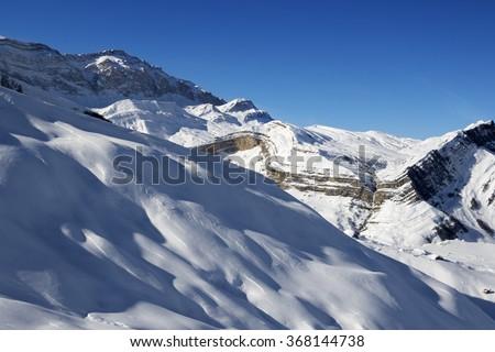 Off-piste slope at nice sun evening. Greater Caucasus, Mount Shahdagh. Qusar rayon of Azerbaijan. - stock photo