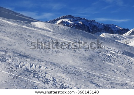 Off-piste slope at sun windy day. Greater Caucasus, Mount Shahdagh. Qusar rayon of Azerbaijan. - stock photo