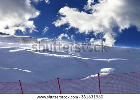 Off-piste slope during a blizzard and sunlight blue sky with clouds. Greater Caucasus, Shahdagh. Qusar rayon of Azerbaijan. - stock photo