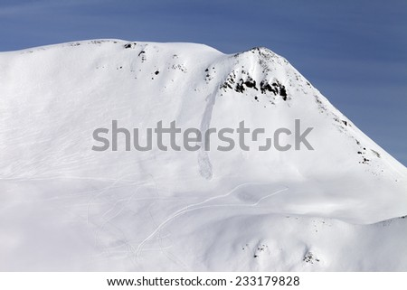 Off-piste slope with traces from avalanches. Caucasus Mountains, Georgia, ski resort Gudauri. - stock photo