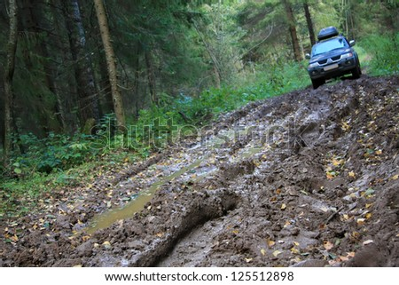 Off-road Action in the forest, 4x4, mud and vehicle - stock photo