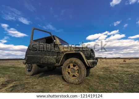 off-road landscape under blue sky - stock photo
