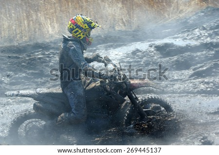 Off-road rider  against a steaming ground   Nakhodka Russia 04.12.2015
