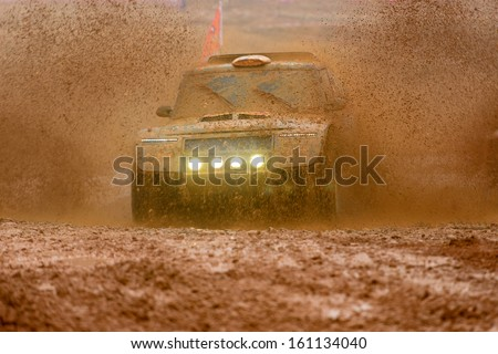 Off-road vehicles to advance bravely splashed mud - stock photo
