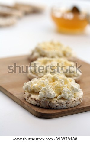 offering gluten-free breakfast- rice waffles with white cheese and honey