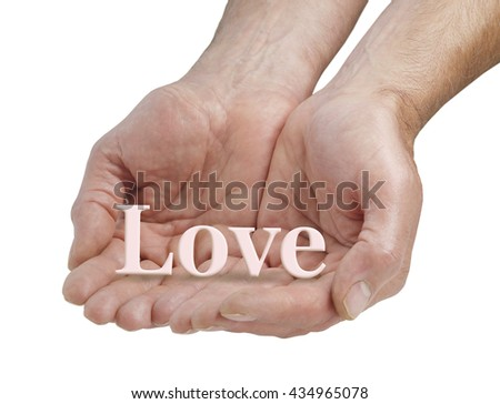 Offering you pure love - male cupped hands with the word LOVE floating above his fingers on a white background - stock photo