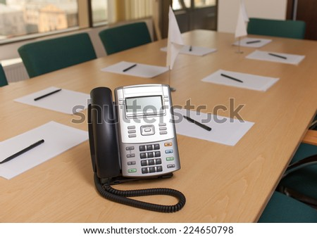 Officce phone on table in meeting room - stock photo