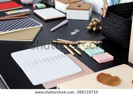 Office and school set with stationery and notebooks on a table - stock photo