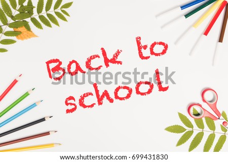 Office and student accessories on a white. Supplies on white background,  top view. Back to school text concept. Copy space
