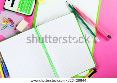 Office and student tools on pink background closeup - stock photo