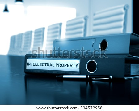 Office Binder with Inscription Intellectual Property on Office Desktop. Intellectual Property - Illustration. Toned Image. 3D Render. - stock photo