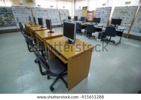 Office blur background with wooden desk
