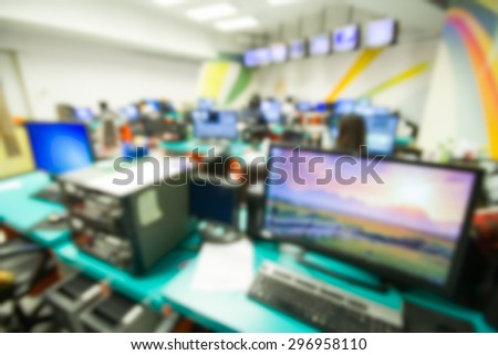 office blur background with worker and computer