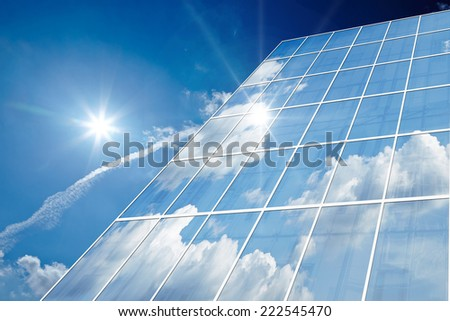 Office building details reflecting, blue sky - stock photo