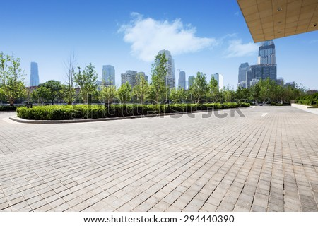 office building exterior with brick road floor - stock photo