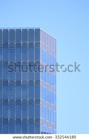 Office building facade with blue crystals. Empty copy space for editor's text.