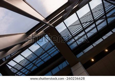 Office building in a metropolitan area with windows and sky - stock photo