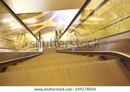office building  interior escalators and stairs - stock photo