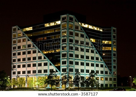 Office building lit up at night with no business or employees around