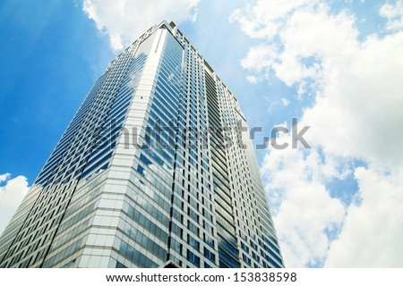 Office building on sky background. - stock photo