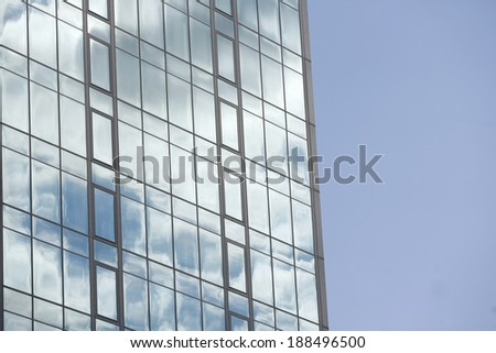Office building on sky background - stock photo