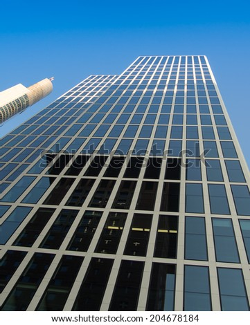 Office building ( Taunus Tower ) in Frankfurt, Germany, one of the most fascinating financial areas of Europe - stock photo