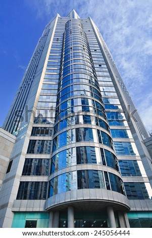 Office building with a glass surface and cylinder shaped front.  - stock photo