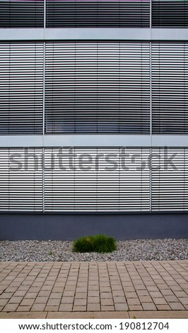 Office building with closed silver shutter blinds - stock photo