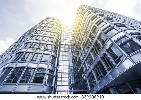 office building with glass windows blue sky cloudy blue glass top modern office