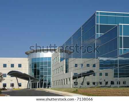 Office Building with stone and glass exterior - stock photo