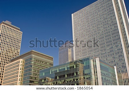 Office buildings against blue sky background