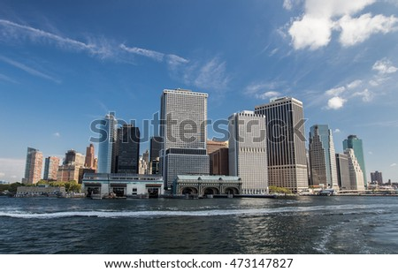 Office buildings of southern Manhattan with Governor's Island ferry docking.