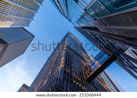 Office buildings stretch up to the blue sky in the financial district in downtown Toronto Ontario Canada. - stock photo