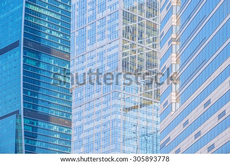 Office buildings walls in the business city center at sunset time. - stock photo